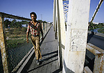 A Mexican day worker crosses U.S. Border in Del Rio, Texas.  While the traditional mission of the United States Border Patrol has always been the detection and prevention of the illegal entry of aliens and smuggling of illegal contraband into the United States anywhere other than a designated port-of-entry, the dawn of the age of terrorism within our nation has added a new and high priority mission: to detect and prevent the entry of terrorists and their weapons into the United States. Jim Bryant Photo..&copy;2006. All Rights Reserved.