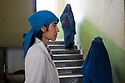 Dr. Wakila talks to a patient in Faizabad Provincial Hospital where she has been working for 20 years in the OBG department. Shortage of skilled female staff is still a problem in remote areas like Badakshan where there's still a very traditional and strict divide between men and women. Afghanistan, 2012