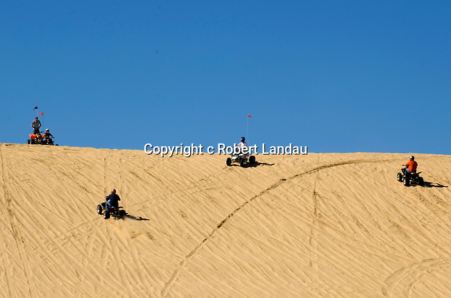 Dune buggy riders at park in Dunes City, OR