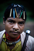 Damo Pusika poses for a portrait in Salpojola village in Niyamgiri hills. He is one of the many people who will get displaced if the aluminium company Vedanta carries on with its plans of mining of Bauxide in Niyamgiri hills in Rayagara district of Orissa in India.