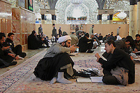 Teacher and student of the Feiziyeh madrasa in Qom talking in the Massoumeh mosque.