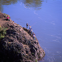 """Sports Fishermen fishing off """"Idiot Rock"""" in the Bulkley River and Moricetown Canyon, near Moricetown, Northern BC, British Columbia, Canada"""