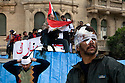 wounded anti-Hosni Mubarak protesterscontinue to man makeshift barricades to defend against surging Mubarak supporters near Tahrir square area February 03, 2011  in Cairo, Egypt. Protesters from both sides clashed throughout the day, throwing rocks and fighting at close range. . .Photo by Scott Nelson