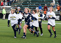 Jessica Schuveiller (12) of Notre Dame celebrates the win with teammates after the final of the NCAA Women's College Cup at WakeMed Soccer Park in Cary, NC.  Notre Dame defeated Stanford, 1-0.