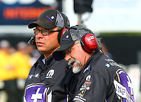 May 15, 2015; Commerce, GA, USA; Crew chiefs Jimmy Prock (left) and John Medlen for NHRA funny car driver Jack Beckman (not pictured) during qualifying for the Southern Nationals at Atlanta Dragway. Mandatory Credit: Mark J. Rebilas-USA TODAY Sports