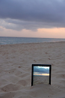Sunrise filmed by a  Digital tablet in sand on beach, Punta Cana, Dominican Republic