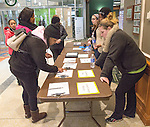 Service leader, Barb Harrison and student leaders, Shana Spade and Naa Djormor help volunteers sign in for the MLK Day or Service at Ohio University.