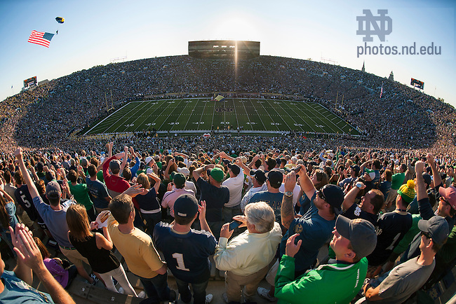 Sept. 6, 2014; A paratrooper with the American flag lands in Notre Dame Stadium prior to the Michigan game. (Photo by Barbara Johnston/ University of Notre Dame)