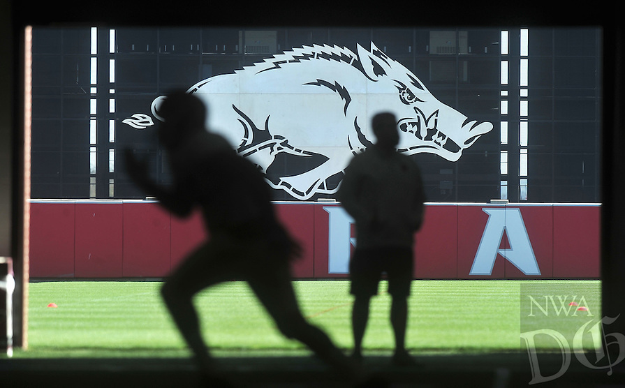 NWA Democrat-Gazette/MICHAEL WOODS &bull; @NWAMICHAELW<br /> University of Arkansas football players run  drills during practice Tuesday, April 5, 2016 in Fayetteville.