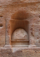 Sacred stone or baetyl at Sabinos Alexandros Station in the Siq, 2nd - 3rd century AD, Petra, Ma'an, Jordan. This votive niche in the Siq wall was carved by Sabinos Alexandros, master of religious ceremonies at Dara'a in Syria, and offers protection to those walking the Siq. It depicts an ovoid representation of the god Dushara of Adra'a (today's Dara'a in Syria). Petra was the capital and royal city of the Nabateans, Arabic desert nomads. Picture by Manuel Cohen