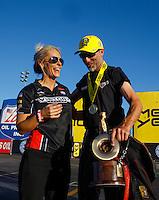 Nov 13, 2016; Pomona, CA, USA; NHRA pro stock motorcycle rider Matt Smith (right) celebrates with wife Angie Smith after winning the Auto Club Finals at Auto Club Raceway at Pomona. Mandatory Credit: Mark J. Rebilas-USA TODAY Sports