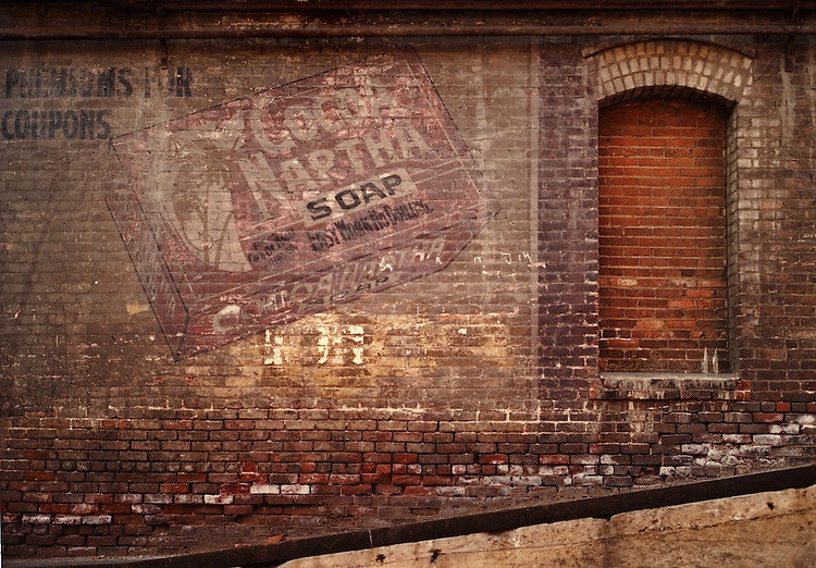 Old brick Naptha sign on a downtown Los Angeles building