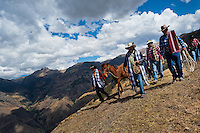 Peruvian peasants lead a horse during a ceremony prior to the Yawar Fiesta, a ritual fight between the condor and the bull, held in the mountains of Apurímac, Cotabambas, Peru, 28 July 2012. The Yawar Fiesta (Feast of Blood), an indigenous tradition which dates back to the time of the conquest, consists basically of an extraordinary bullfight in which three protagonists take part - a wild condor, a wild bull and brave young men of the neighboring communities. The captured condor, a sacred bird venerated by the Indians, is tied in the back of the bull which is carefully selected for its strength and pugnacity. A condor symbolizes the native inhabitants of the Andes, while a bull symbolically represents the Spanish invaders. Young boys, chasing the fighting animals, wish to show their courage in front of the community. However, the Indians usually do not allow the animals to fight for a long time because death or harm of the condor is interpreted as a sign of misfortune to the community.