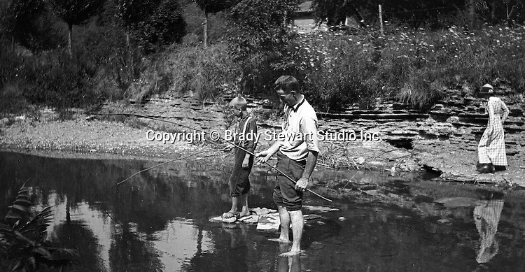 Erie PA:  Family fishing in stream near Lake Erie - 1915