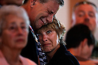 PUNTA GORDA, FL -- March 13, 2008 -- Kevin Hall cries with his wife, Becky Hall, as they mourn the loss of their son during a memorial service for former Marine Eric Hall at the Faith Lutheran Church in Punta Gorda, Fla., on Thursday, March 13, 2008.  Hall went missing on Feb. 3 after having a flashback to his time in Iraq, and was found dead weeks later by the Vietnam veteran volunteers in a culvert.