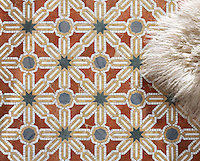 Alcazar, a natural stone waterjet and hand cut mosaic shown in Spring Green, Blue Macauba, Rojo Alicante and Renaissance Bronze polished, is part of the Miraflores Collection by Paul Schatz for New Ravenna Mosaics.