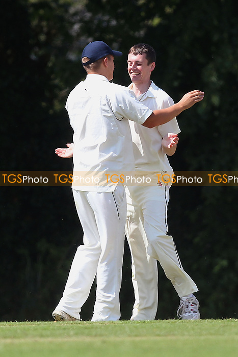 M Roe of Havering (R) celebrates the fourth Herongate wicket - Herongate CC vs Havering-atte-Bower CC - Mid-Essex Cricket League - 21/06/14 - MANDATORY CREDIT: Gavin Ellis/TGSPHOTO - Self billing applies where appropriate - 0845 094 6026 - contact@tgsphoto.co.uk - NO UNPAID USE