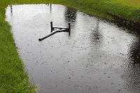 Rain is a rare sight during Falsterbo Horse Show. Due to raining the whole summer 2007 the ground water level is high. A lone stand is swimming in the water filled Devil's Dyke.<br /> Horse Trials have since the 1920s proud traditions on the Falsterbo Peninsula in southwestern Sweden, nowadays run as the international meeting Falsterbo Horse Show.<br /> In 2007 685 horses from 15 countries competed during the seven days of the meeting.<br /> July 2007, one week after the show.<br /> Only for editorial use.