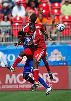 05 June 2010: Kansas City Wizards forward Kei Kamara #23 collides with Toronto FC defender Nana Attakora #3 and Toronto FC defender Dan Gargan #8  during a game between the Kansas City Wizards and Toronto FC at BMO Field in Toronto..The game ended in a 0-0 draw.