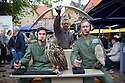 "Edinburgh, UK. 09.08.2016. Cast members, Lewis Howard (as Callum), Alan Munden, and  Ben Dyson (as Paddy) from ""Swivelhead"", Pipeline Theatre's new play, meet a barn owl and an eagle owl in the courtyard at the Pleasance. ""Swivelhead"" runs from 3rd - 29th August in Peasance 2. Photograph © Jane Hobson."
