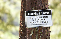 """""""Burial Site, No Camping, No ATV''s, No Vehicles"""" sign posted on tree in Waipi'o Valley, Big Island."""