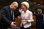 French defence minister Jean-Yves Le Drian speaks with German defence minster Ursula von der Leyen at the EU Council.