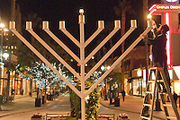 Rabbi Eli Levitansky, 30, from the Chabad  House, lights the Menorah at the Third Street Promenade during the first night of Chanukah on Wednesday, December 1, 2010.