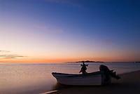 Fishing boat sits on shore of Sea of Cortez at dawn, San Felipe, Baja California, Mexico