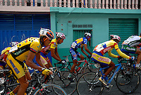 Athletes compete in stage five of the annual Vuelta al Tachira cycling race in Merida, Venezuela on Wednesday, Jan. 9, 2008. Local and international teams will ride over 1580 kilometers and climb a 1500 meter altitude differential throughout the competition. The grueling, 13-stage race through the Andes mountains is hailed as the premier cycling event in South America. ..