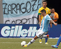 Argentina midfielder Jose Sosa (8) clears the ball. In an international friendly (Clash of Titans), Argentina defeated Brazil, 4-3, at MetLife Stadium on June 9, 2012.