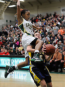 Nikki Nellen of Pius Xi is fouled by Racine Cases' JaToya Woods during the WIAA playoff game at Wisconsin Lutheran College on Tuesday, March 22, 2011. Ernie Mastroianni photo.