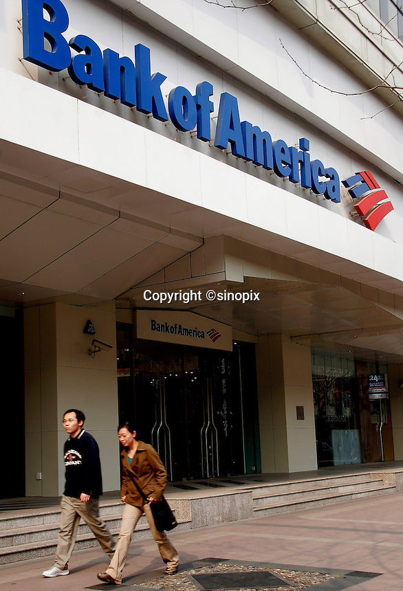 Pedestrians walk past a Bank of America in Shanghai, China. Bank of America is considering a substantial investment in a large Chinese bank as it seeks to expand services outside of the U.S., the interest is likely centered on the China Construction Bank and the Bank of China..