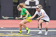 Towson, MD - March 25, 2017: Oregon Ducks Cambi Cukar (22) and Towson Tigers Kelly McQuilkin (5) tries to get the ball during game between Towson and Oregon at  Minnegan Field at Johnny Unitas Stadium  in Towson, MD. March 25, 2017.  (Photo by Elliott Brown/Media Images International)