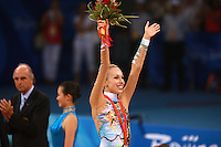August 23, 2008; Beijing, China; Rhythmic gymnast Inna Zhukova of Belarus celebrates winning silver in Individual All-Around during medal ceremony at 2008 Beijing Olympics..(©) Copyright 2008 Tom Theobald