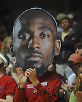 "Students cheer and hold masks of Ole MIss senior guards Chris Warren  at C.M. ""Tad"" Smith Coliseum in Oxford, Miss. on Saturday, March 5, 2010. Ole Miss beat Arkansas 84-74."