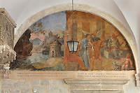Mural, with an angel appearing to Mary and Jesus, on the wall of the Cloister, built in late Romanesque style by Mihoje Brajkov of Bar in 1360, in the Franciscan monastery on Stradun or Placa, Old Town, Dubrovnik, Croatia. The city developed as an important port in the 15th and 16th centuries and has had a multicultural history, allied to the Romans, Ostrogoths, Byzantines, Ancona, Hungary and the Ottomans. In 1979 the city was listed as a UNESCO World Heritage Site. Picture by Manuel Cohen