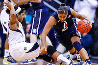 SOUTH BEND, IN - MARCH 04: Ariel Braker #44 of the Notre Dame Fighting Irish falls as Kaleena Mosqueda-Lewis #23 of the Connecticut Huskies dribbles around her at Purcel Pavilion on March 4, 2013 in South Bend, Indiana. Notre Dame defeated Connecticut 96-87 in triple overtime to win the Big East regular season title. (Photo by Michael Hickey/Getty Images) *** Local Caption *** Ariel Braker; Kaleena Mosqueda-Lewis
