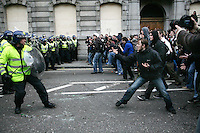 Police confront demonstrators as thousands of protestors descended on the City of London ahead of the G20 summit of world leaders to express anger at the economic crisis, which many blame on the excesses of capitalism.