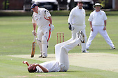 Richard Symmonds of Gidea Park goes down with an injury after attempting a catch off of his own bowling - Hornchurch CC (batting) vs Gidea Park & Romford CC - Essex Cricket League - 20/08/11 - MANDATORY CREDIT: Gavin Ellis/TGSPHOTO - Self billing applies where appropriate - 0845 094 6026 - contact@tgsphoto.co.uk - NO UNPAID USE.