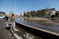 Tahrir square being cleaned after protesters were chased away. Some protesters still occupied the Tahrir Square until March 9, when they were chased away by armed men,  while life in other parts of the city returned to normal.