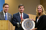 Mayor Will Wynn and City Manager Toby Futrell accept LEED Gold Award for Green Building Design for Austin City Hall.