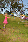Stock photo of child playing with  bubbles