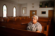 August 7, 2010. New Hill, North Carolina.. Elaine Joyner sits in the sanctuary of the 1st Baptist Church of New Hill. The congregation has led the effort to get the town's African American residents involved in the fight agains the proposed sewage plant.. A coalition composed of the towns of Cary, Apex, Morrisville and Holly Springs has proposed to build a waste water treatment plant in the unincorporated town of New Hill, in southern Wake County.. The residents only found out about the proposed site through a Cary resident and have been fighting the plant ever since as it brings no benefits to their town, only to the larger members of the coaltition.