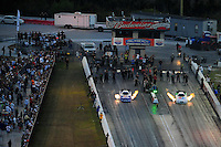 Jan. 21, 2012; Jupiter, FL, USA: Aerial view of NHRA funny car driver Matt Hagan (left) races alongside Jack Beckman during testing at the PRO Winter Warmup at Palm Beach International Raceway. Mandatory Credit: Mark J. Rebilas-