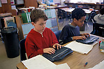 Berkeley CA 5th graders writing compositions on Alphasmart word processors in class