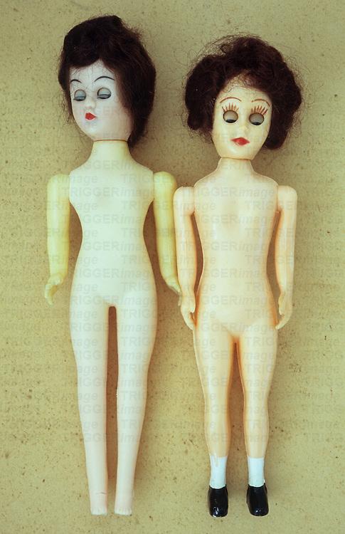 Old fashioned plastic female dolls with dark hair