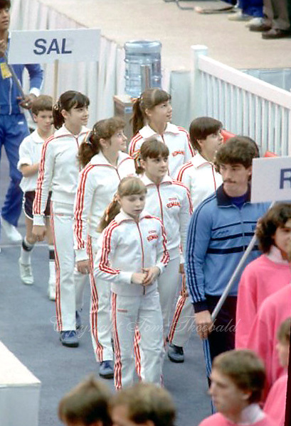 (L-R) Several team members including Laura Cutina, Ecaterina Szabo,  Eugenia Golea, Camelia Voinea and front foreground Daniela Silivas of  Romania march-in during opening ceremony at 1985 World Championships in women's artistic gymnastics at Montreal, Canada in mid-November, 1985.  Photo by Tom Theobald.