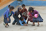 Children play basketball during a recess from school in Tuixcajchis, a small Mam-speaking Maya village in Comitancillo, Guatemala.