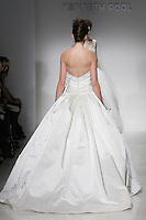 Model walks runway in a Bridgette wedding dresses by Amsale Aberra, for the Kenneth Pool Spring 2012 Bridal runway show.