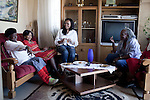 SOWETO, SOUTH AFRICA - MAY 15: Event agency owner Palesa Gcaba (c) chats with her mother and older relatives in the house where she grew up in on May 15, 2010, in Soweto, South Africa. Palesa is part of the new young generation of black South African's who has obtained a better education and opportunities than their parents. She organizes big events for government departments and private business. Because of being  black and a women, she can tender for government contracts much easier than being a white person. She lives in a posh Johannesburg suburb and drives a late model BMW. Soweto is the largest township in South Africa, located about 10 kilometers southwest of downtown Johannesburg. The population is estimated to be around 2-3 million. (Photo by Per-Anders Pettersson)